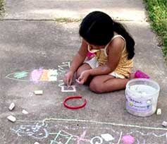 girl making chalk drawing